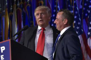 Donald Trump (L) gives a speech next to Reince Priebus on election night in New York, 9 November