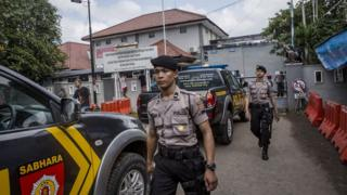 CILACAP, CENTRAL JAVA, INDONESIA - JULY 27: Indonesian police walk as guard at Wijayapura port, which is the entrance gate to Nusakambangan prison as Indonesia prepare for third round of drug executions on July 27, 2016