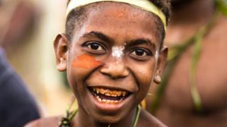 Young boy with betel nut stained teeth