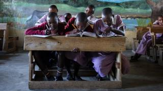 Masai children studying in a classroom of the Nkoilale primary school in Narok district in Kenya