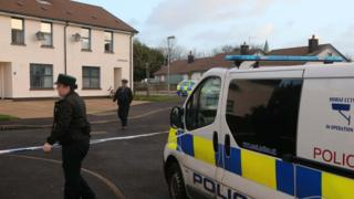 Police officers at the scene n Ballycastle where Anthony McErlain's body was found
