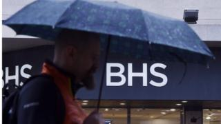 BHS store with man and umbrella in front