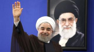 Newly re-elected Iranian President Hassan Rouhani gestures after delivering a televised speech in the capital Tehran