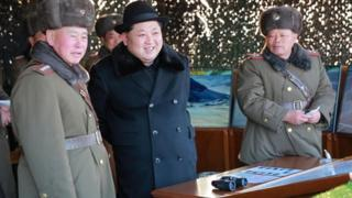 General Ri Myong-su (L), the new chief of the Korean People's Army General Staff, stands next to North Korean leader Kim Jong-un
