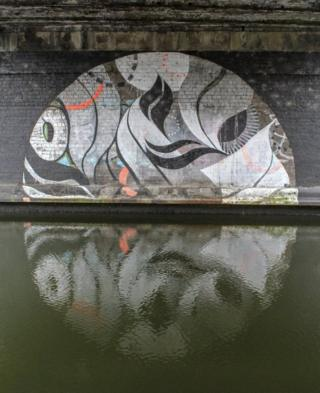 Artwork reflected in water