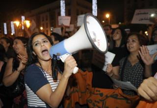 Moroccans shout slogans as they hold placards during a demonstration against the arrest of two Moroccan women after their outfits were deemed inappropriate, in Rabat, Morocco, 29 June 2015. Two Moroccan women, who walked through a market wearing dresses, are facing charges of 'gross indecency', sparking an outcry in Morocco. The women were arrested on 16 June as they strolled through the open-air market in Inezgane, near Agadir city