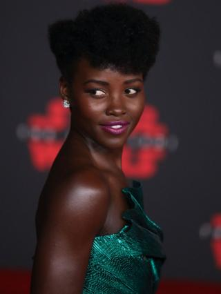 "Kenyan-Mexican actress Lupita Nyong""o poses on the red carpet during the entire world premiere of ""Star Wars: The Last Jedi"" at the Shrine Auditorium in Los Angeles, California, USA, 09 December 2017. Nyong""o plays the role of Maz Kanata inside the film."