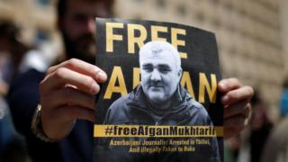 A man attends a rally in Tbilisi, Georgia on 31 May 2017 to support Azeri Journalist Afgan Mukhtarli, who was abducted in Tbilisi on 29 May and now is in detention in Baku, Azerbaijan