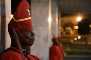 Senegalese guard of honor waits at the airport for the arrival ceremony of French President Emmanuel Macron at the airport on Febuary 2, 2018, in Dakar.