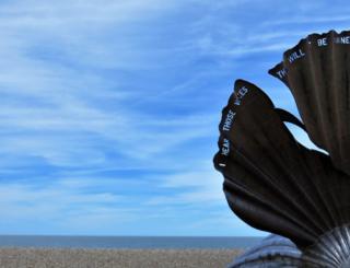 A shell sculpture on a beach