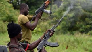 """Mutinous soldiers fire in the air inside a military camp in Ivory Coast""""s central second city Bouake, on May 15, 2017."""