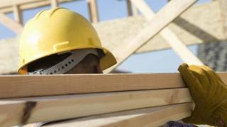 Builder with planks