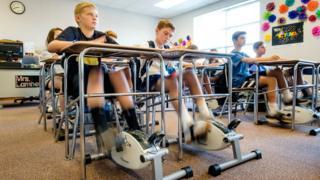 Pupils with bike pedals under their desks