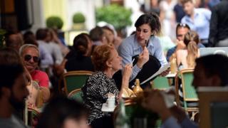 Waitress at table