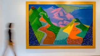 A blurred figure walking past David Hockney's Pacific Coast Highway and Santa Monica