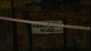 Police Cordon tape over Harlesden Road sign