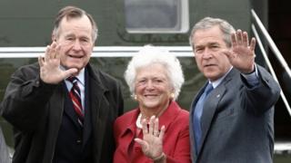 George Bush Snr, Barbara Bush and George Bush Jnr wave to the camera