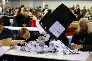 Election staff count ballot papers for the General Election, at the Emirates Arena in Glasgow.