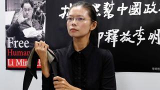 李明哲妻子李凈瑜9月9日召开行前记者会。