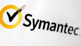 Symantec Logo - a yellow circle with a tick in it