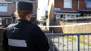 A police officer at the scene of Michael McGibbon's murder