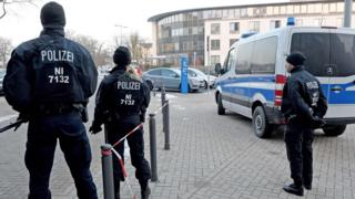 Policemen stand in front of the Higher Regional Court in Celle near Hanover as Safia S is sentenced