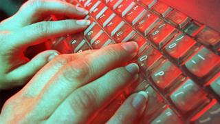 File image of hands typing on keyboard
