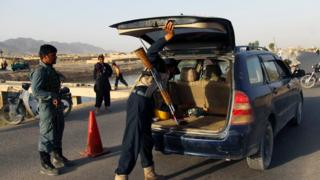 Police conduct a vehicle search in Kandahar after the reported kidnapping
