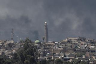 Smoke rising above al-Nuri mosque