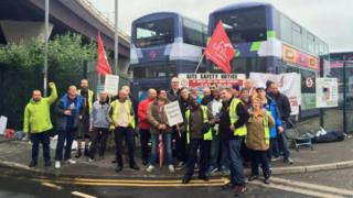 Union members outside a bus depot