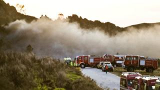 Emergency workers at the site of a fireworks factory, in Avoes, Lamego, Portugal on 4 April