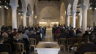 Christians attend a mass at the Church of the Multiplication of the Loaves and Fish in Tabgha