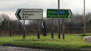 Road signs for Castledawson, Bellaghy, Belfast and Magherafelt