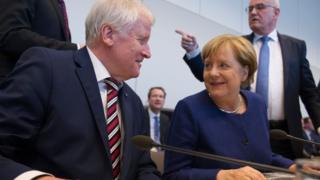 Angela Merkel meets Horst Seehofer, leader of the CDU's Bavarian ally, the Christian Social Union (CSU) on 26 Sept