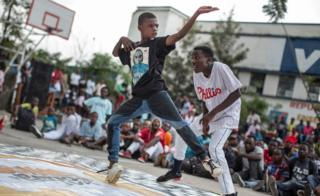 Twelve-year-old Kennedy Mukadi Chilobo (L) competes in a team dance battle at the Goma Dance Festival in Goma, east of the Democratic Republic of the Congo, on April 30, 2017. In its first year, the festival aims to support and encourage young Congolese to express themselves through the medium of dance.