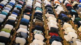 Muslims praying in London