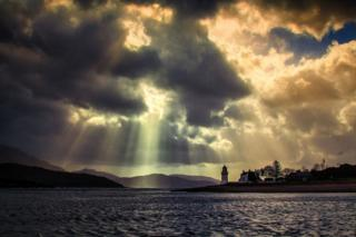 Sun's rays through the clouds as Coran ferry takes detour