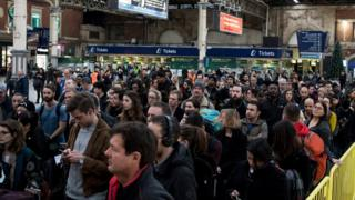 Passengers waiting for a delayed service at London Victoria during a strike day on 13 December