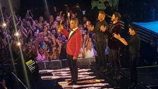 Robbie Williams and Take That on stage at the Troxy in London