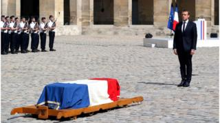 Emmanuel Macron (R) stands in front of the flag-draped coffin of Simone Veil during a solemn funeral ceremony, in the courtyard of the Invalides in Paris, France, 05 July 2017.