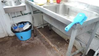 Dirty kitchen at shop