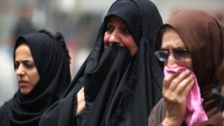 Women weep at the site of a suicide bombing in Baghdad's Karrada district (4 July 2016)