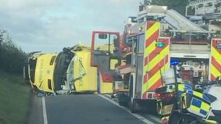 Ambulance turned on its side and fire engine