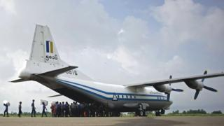A Myanmar Air Force Shaanxi Y-8 transport aircraft being unloaded at Sittwe airport in Rakhine state, of the same type as the plane that is missing (file photo)