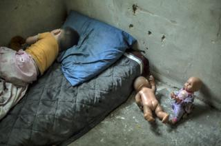 Nikoloz Beriashuili, aged two-years-old, sleeps in the one room he shares with his mother, father and sister