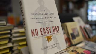 Copies of a book by former Navy SEAL titled No Easy Day are seen on display at a bookstore in Washington, DC