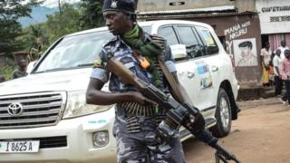 A security guard holds a gun in Kabezi, about 30km south of Bujumbura, Burundi, on May 11, 2018