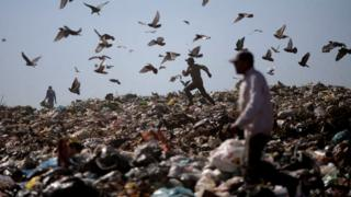 A man runs at Lixao da Estrutural, Latin America's largest rubbish dump, in Brasilia, Brazil, 19 January 2018