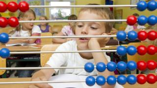 Boy with abacus