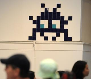 A work by French street artist Invader is on display at the 'Art In The Streets' exhibition inside the Museum of Contemporary Art (MOCA) in Los Angeles in 2011.
